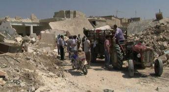 Från Azaz i Syrien efter flygbombardemang i augusti 2012. Bild från Scott Bobb, Voice of America via Wikimedia.