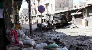 Utbombade fordon i Aleppo (Voice of America via Wikimedia).